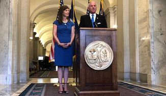 South Carolina Lt. Gov. Pamela Evette, left, and Gov. Henry McMaster, right, discuss McMasters budget vetoes during a news conference, Wednesday, May 29, 2019, in Columbia, S.C. McMaster said his few vetoes show a willingness to cooperate between lawmakers and himself. (AP Photo/Jeffrey Collins)