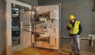 FILE - In this Oct. 27, 2015 file photo, a worker at the Blue Grass Chemical Agent Pilot Plant looks at a blast door inside the facility in Richmond, Ky. Senate Majority Leader Mitch McConnell, military leaders and Gov. Matt Bevin were in Richmond on Wednesday, May 29, 2019, to ceremonially mark the beginning of the elimination of more than 500 tons of mustard gas, sarin or VX agent stored at the Army depot.  (AP Photo/Dylan Lovan, File)