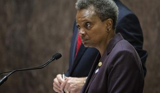 Mayor Lori Lightfoot presides over her first city council meeting at City Hall in Chicago on Wednesday, May 29, 2019. (Ashlee Rezin/Chicago Sun-Times via AP)