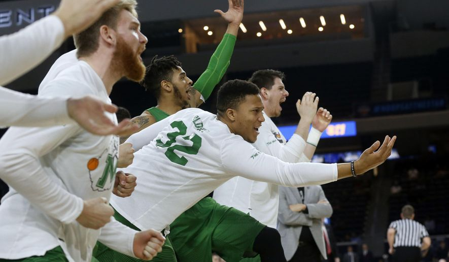 FILE - In this Saturday, March 10, 2018, file photo, then-Marshall guard Phil Bledsoe (32) and the Marshall bench react to a 3-point shot against Western Kentucky during the second half of the NCAA Conference USA basketball championship game in Frisco, Texas. Confusion over the new rule allowing college basketball players to sign with agents has led to uncertainty for Bledsoe, now at Division II Glenville State in West Virginia. (AP Photo/Michael Ainsworth, File)