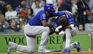 Chicago Cubs' Albert Almora Jr., right, is comforted by Jason Heyward after hitting a foul ball into the stands during the fourth inning of a baseball game against the Houston Astros Wednesday, May 29, 2019, in Houston. (AP Photo/David J. Phillip)