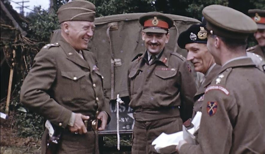 Gen. George Patton, with a pearl-handled pistol, talks to French officers in France during World War II. Years later, surprising color images of the D-Day invasion and aftermath bring an immediacy to wartime memories. They were filmed by Hollywood director George Stevens and rediscovered years after his death. (War Footage From the George Stevens Collection at the Library of Congress via AP) ** FILE **