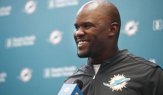 FILE - In this May 14, 2019, file photo, Miami Dolphins head coach Brian Flores speaks before NFL football practice in Davie, Fla. As Flores settles into his job as coach of the Miami Dolphins, he's trying to establish a culture and choose quarterback.(AP Photo/Brynn Anderson, File)