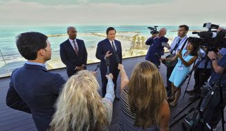 With the Mediterranean Sea as a backdrop, Florida Gov. Ron DeSantis speaks to reporters Monday, May 27, 2019, ahead of the first full day of a Florida trade delegation trip to Israel. DeSantis is leading a delegation on a four-day trade mission to help boost the state's economy and solidify its bonds with Israel.  (Jeff Schweers/Tallahassee Democrat via AP)