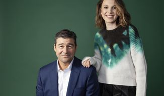 """This May 19, 2019 photo shows Kyle Chandler, left, and Millie Bobby Brown posing for a portrait at the London Hotel in West Hollywood, Calif., to promote their new film """"Godzilla: King of the Monsters."""" (Photo by Rebecca Cabage/Invision/AP)"""