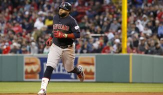 Cleveland Indians' Carlos Santana rounds second base after hitting a solo home run during the fourth inning of the team's baseball game against the Boston Red Sox, Wednesday, May 29, 2019, in Boston. (AP Photo/Mary Schwalm)