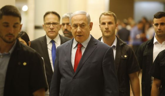 Israeli Prime Minister Benjamin Netanyahu walks in the Knesset, Israel's parliament in Jerusalem, Wednesday, May 29, 2019. Israeli Prime Minister Benjamin Netanyahu faced a deadline at midnight Wednesday to form a new governing coalition as he tried to stave off a crisis that could trigger an unprecedented second election this year or even force the longtime leader to step down. (AP Photo/Sebastian Scheiner)