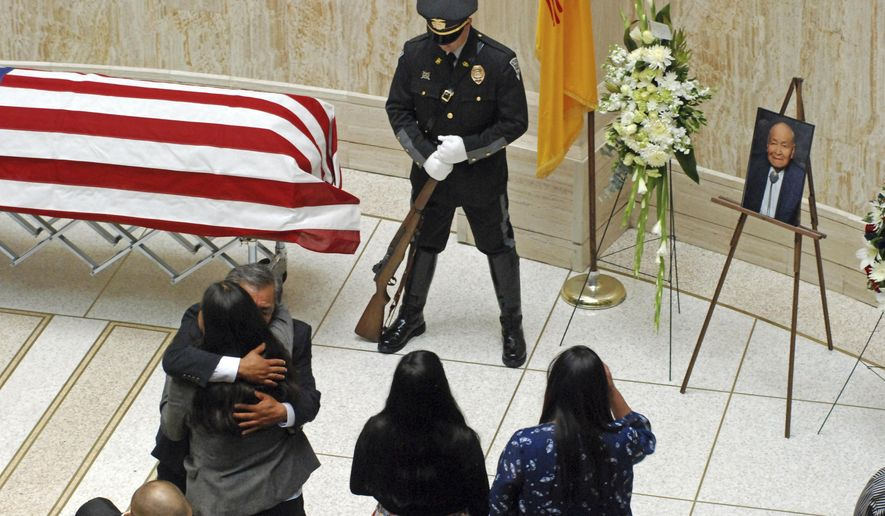 Mourners gathered to remember deceased state Sen. John Pinto at the state Capitol in Santa Fe, N.M., on Wednesday, May 29, 2019. Pinto died on Friday at age 94 after serving 42 years in the state Senate. He trained as a Navajo code talker to encrypt radio messages in World War II and helped authorize spending this year for a museum about the code talkers. (AP Photo/Morgan Lee)