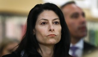FILE - In this March 18, 2019, file photo, Michigan Attorney General Dana Nessel attends an event for Democratic presidential candidate Sen. Kirsten Gillibrand, D-N.Y., in Clawson, Mich. Nessel says she will move next month to decommission a Great Lakes oil pipeline if Gov. Gretchen Whitmer cannot resolve the issue with operator Enbridge. The Democrat spoke on Wednesday, May 29, 2019 at the Detroit Regional Chamber's policy conference on Mackinac Island, near where where Line 5 runs under the Straits of Mackinac. (AP Photo/Paul Sancya File)