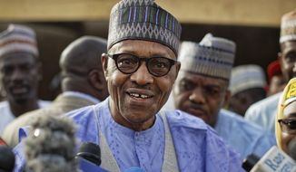 FILE - In this Saturday, Feb. 23, 2019 file photo, Nigeria's President Muhammadu Buhari speaks to the media after casting his vote in his hometown of Daura, in northern Nigeria. Nigeria's President Muhammadu Buhari has been sworn in for a second four-year term in Africa's most populous country on Wednesday, May 29. The 76-year-old former military dictator faces heightened pressure to defeat Islamic extremism and boost the oil-dependent economy amid concerns over his health.(AP Photo/Ben Curtis, File)