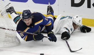 St. Louis Blues center Robert Thomas (18) falls as he chases the puck with San Jose Sharks left wing Evander Kane (9) during the first period in Game 6 of the NHL hockey Stanley Cup Western Conference final series Tuesday, May 21, 2019, in St. Louis. (AP Photo/Tom Gannam)
