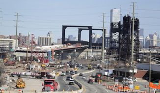 FILE - This April 17, 2019, file photo general view of the construction site of the new Route 7 drawbridge in Kearny, N.J. Small businesses want the federal government to follow through on promises of $2 trillion to rebuild the nation's infrastructure. (AP Photo/Julio Cortez, File)