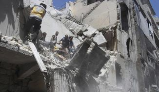 This photo posted on Tuesday, May 28, 2019 and provided by the Syrian Civil Defense White Helmets, which has been authenticated based on its contents and other AP reporting, shows Civil Defense workers inspecting a damaged building after an airstrike by Syrian government forces, in the town of Ariha, in the northwestern province of Idlib, Syria. Syrian activists and rescuers say government warplanes and artillery have pounded the last rebel stronghold in the country, killing over a dozen people. (Syrian Civil Defense White Helmets via AP)