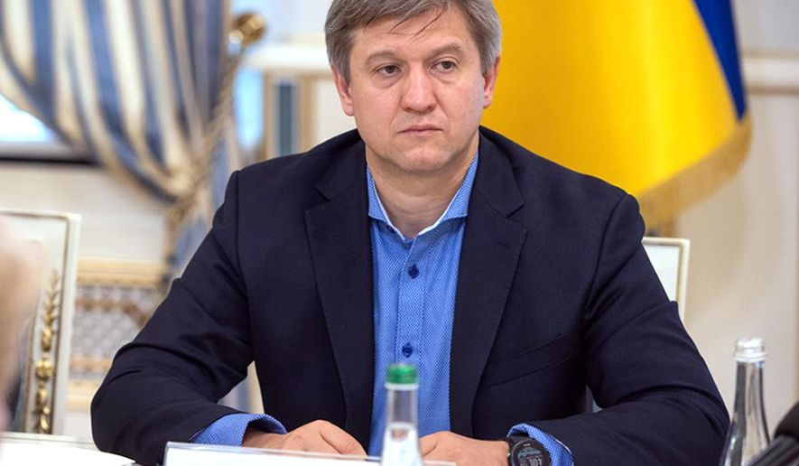 In this photo taken on Tuesday, May 28, 2019, Oleksandr Danylyuk, the new chairman of the Ukrainian National Security and Defense Council attends a meeting with the mission of the International Monetary Fund, in Kiev, Ukraine. Danylyuk discovered that all the equipment from the room where the head of the state is supposed to be discussing the most urgent matters of national security is gone. (Ukrainian Presidential Press Office via AP)