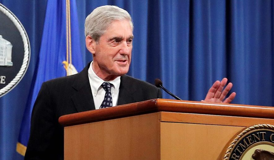 Special counsel Robert Mueller waves as he walks from the podium after speaking at the Department of Justice Wednesday, May 29, 2019, in Washington, about the Russia investigation. (AP Photo/Carolyn Kaster) ** FILE **