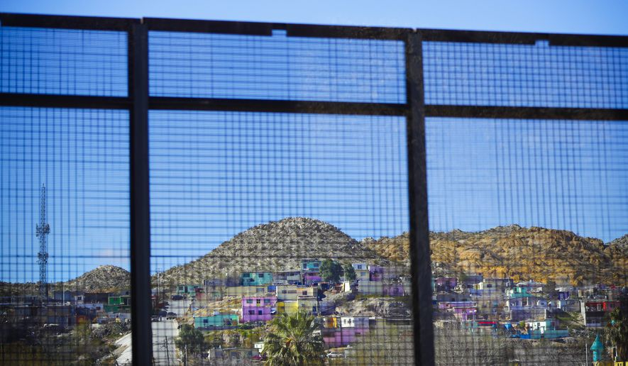 Residential homes in the Mexican city of Ciudad Juarez are seen through border fencing during Acting Secretary of Defense Patrick Shanahan's tour of the US-Mexico border in El Paso, Texas, Saturday, Feb. 23, 2019. (AP Photo/Pablo Martinez Monsivais)