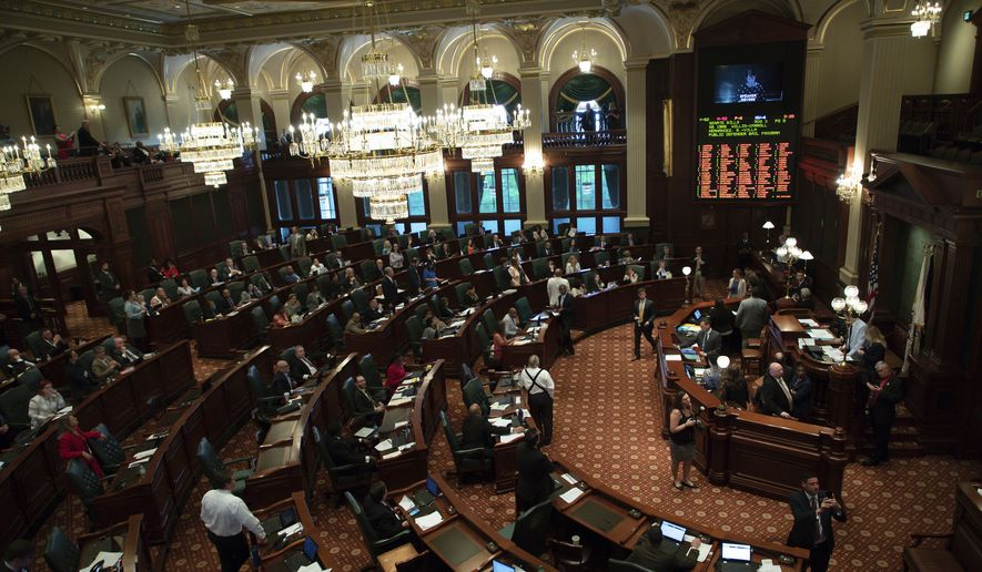 Illinois House debates on a bill requiring gun license applicants to be fingerprinted during spring session of the Illinois General Assembly at the State Capitol in Springfield, Ill., on Wednesday, May 29, 2019. Illinois House approved the bill. The General Assembly is scheduled to adjourn Friday until the fall. (Zbigniew Bzdak/Chicago Tribune via AP)