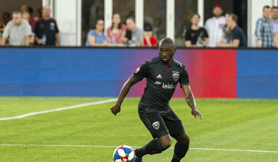 D.C. United back Chris Odoi-Atsem controls the ball and looks for a teammate during a soccer match against the Chicago Fire in Washington, D.C. on Wednesday, May 29, 2019. It marked the first MLS match Odoi-Atsem played since recovering from Hodgkin's lymphoma. (Photo by Xavier Dussaq, courtesy of D.C. United) **FILE**