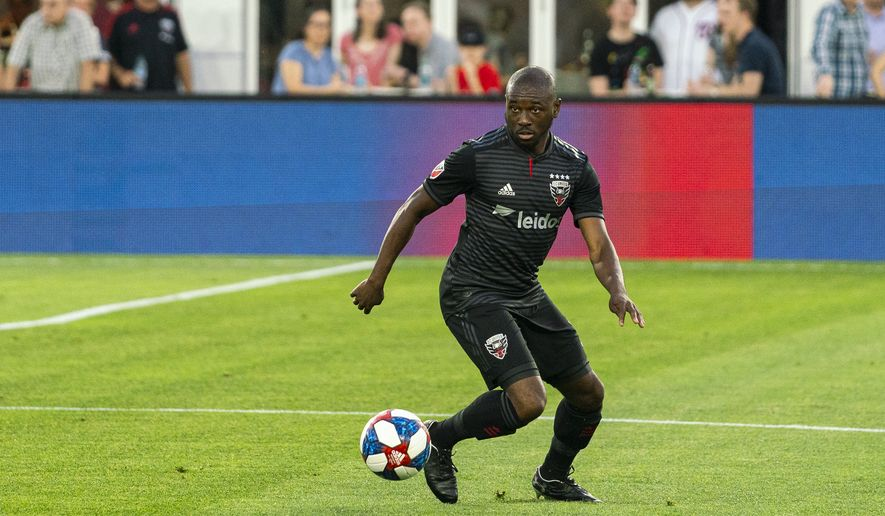 D.C. United back Chris Odoi-Atsem controls the ball and looks for a teammate during a soccer match against the Chicago Fire in Washington, D.C. on Wednesday, May 29, 2019. It marked the first MLS match Odoi-Atsem played since recovering from Hodgkin's lymphoma. (Photo by Xavier Dussaq, courtesy of D.C. United)