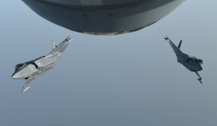 In this Wednesday, May 29, 2019 photo released by the U.S. Air Force, two U.S. F-35A Lightning IIs break away from each other after an aerial refuelling mission over an undisclosed location in Southwest Asia. The F-35s later participated in a formation flight with United Arab Emirates Air Force Desert Falcons and Mirage 2000s to continue building military-to-military relationships with the UAE, according to the Air Force. (Staff Sgt. Chris Drzazgowski/U.S. Air Force via AP)