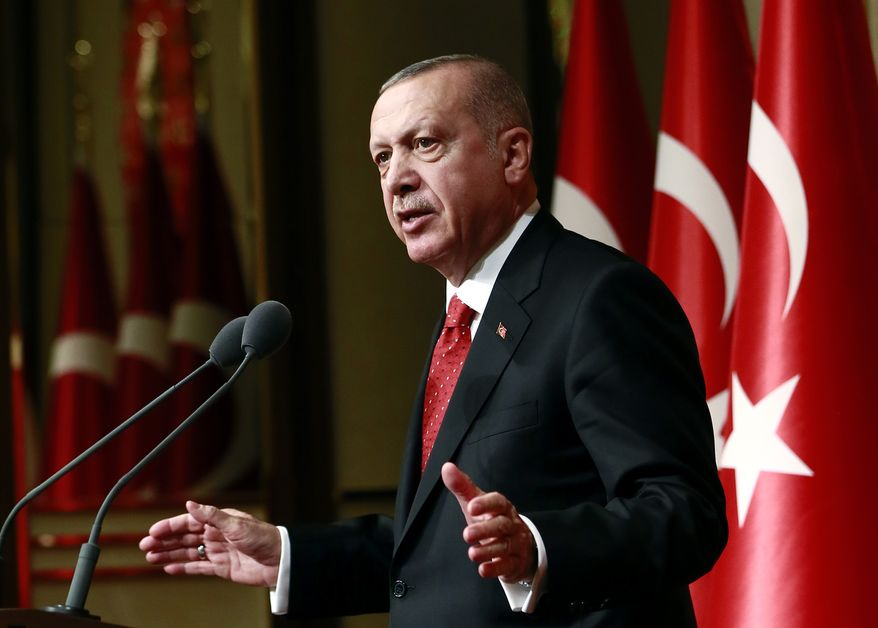 Turkey's President Recep Tayyip Erdogan gestures as he addresses a meeting in Ankara, Turkey, Thursday, May 30, 2019. Erdogan and U.S. President Donald Trump will meet at next month's Group of 20 summit to discuss bilateral issues, including Ankara's plan to buy a Russian missile defense system that has raised the ire of the United States. (Presidential Press Service via AP, Pool)