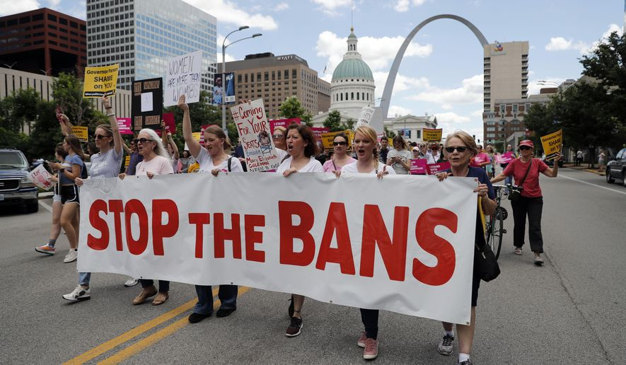 Abortion-rights supporters march Thursday, May 30, 2019, in St. Louis. A St. Louis judge is deciding whether to grant an order that would allow Missouri's only abortion clinic to keep its license to perform abortions past Friday. (AP Photo/Jeff Roberson)