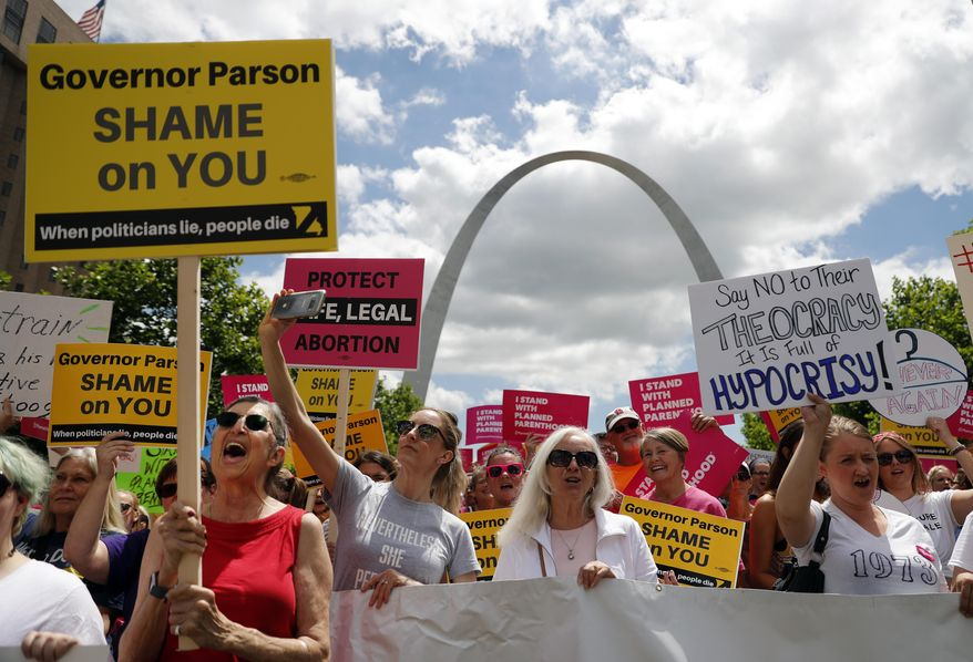 Abortion-rights supporters take part in a protest Thursday, May 30, 2019, in St. Louis. A St. Louis judge heard an hour of arguments Thursday on Planned Parenthood's request for a temporary restraining order that would prohibit the state from allowing the license for Missouri's only abortion clinic to lapse at midnight Friday. (AP Photo/Jeff Roberson)