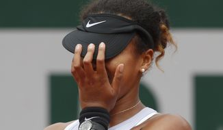 Japan's Naomi Osaka celebrates winning her second round match of the French Open tennis tournament against Victoria Azarenka of Belarus in three sets, 4-6, 7-5, 6-3, at the Roland Garros stadium in Paris, Thursday, May 30, 2019. (AP Photo/Jean-Francois Badias)