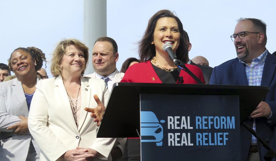 "Michigan Gov. Gretchen Whitmer speaks before signing auto insurance legislation on Thursday, May 30, 2019, at the Detroit Regional Chamber's Mackinac Policy Conference at the Grand Hotel on Mackinac Island, Mich. Whitmer signed the overhaul of Michigan's car insurance system that will let drivers forego unlimited medical benefits to cover crash injuries in which she declared it an ""historic day"" because the cost of auto insurance will go down. (AP Photo/David Eggert)"