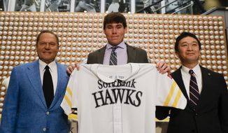 Sports agent Scott Boras, left, SoftBank Hawks pitcher Carter Stewart Jr., center, and Hawks General Manager, Sugihiko Mikasa pose during a baseball news conference in Newport Beach, Calif., Thursday, May 30, 2019. After failing to sign with Atlanta and losing a grievance against the Braves, 19-year-old right-hander Carter Stewart has agreed to a six-year contract with the Fukuoka SoftBank Hawks of Japan's Pacific League (AP Photo/Chris Carlson)