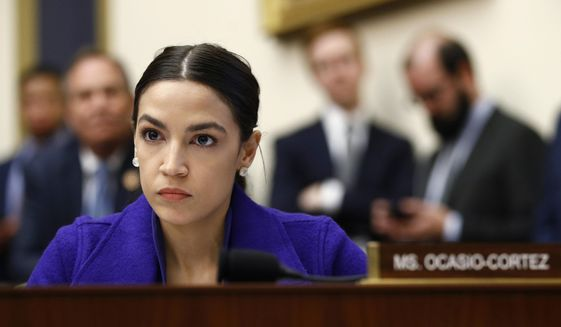 In this Wednesday, April 10, 2019, file photo, Rep. Alexandria Ocasio-Cortez, D-N.Y., listens during a House Financial Services Committee hearing with leaders of major banks on Capitol Hill in Washington.  (AP Photo/Patrick Semansky, File) **FILE**