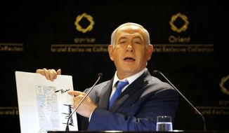 CORRECTS PHOTOGRAPHER TO ARIEL SCHALIT FROM SEBASTIAN SCHEINER - Israeli Prime Minister Benjamin Netanyahu shows a map from US President Donald Trump during statements to the press in Jerusalem, Thursday, May 30, 2019. President Donald Trump's son-in-law and senior adviser Jared Kushner met with Israeli Prime Minister Benjamin Netanyahu on Thursday to push the Trump administration's long-awaited plan for Mideast peace, just as Israel was thrust into the political tumult of an unprecedented second election in the same year. (AP Photo/Ariel Schalit)