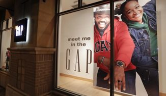 FILE - This Aug. 23, 2018, file photo shows a window display at a Gap clothing store in Winter Park, Fla. The Gap Inc. reports financial results Thursday, May 30, 2019. (AP Photo/John Raoux, File)