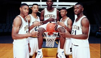 FILE - In this November 1991 file photo, Michigan's Fab Five, from left, Jimmy King, Juwan Howard, Chris Webber, Jalen Rose and Ray Jackson pose in Ann Arbor, Mich. Howard is coming back to Michigan.The former member of the Fab Five agreed to a five-year deal, which will pay him $2 million in his first year, on Wednesday, May 22, 2019, to lead the Wolverines. (AP Photo, File)