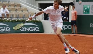Kazakhstan's Alexander Bublik plays a shot against Austria's Dominic Thiem during their second round match of the French Open tennis tournament at the Roland Garros stadium in Paris, Thursday, May 30, 2019. (AP Photo/Pavel Golovkin)