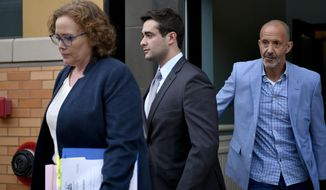 Former Beta Theta Pi house manager Braxton Becker, center, leaves the Centre County Courthouse after being found guilty of one misdemeanor on Thursday, May 30, 2019 in Bellefonte, Pa. Becker was accused of intentionally deleting basement video from the fraternity house after Penn State sophomore Timothy Piazza fell down the steps in 2017.     (Abby Drey/Centre Daily Times via AP)