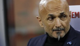 FILE - In this May 13, 2019 file photo, Inter Milan coach Luciano Spalletti sits on the bench during a Serie A soccer match between Inter Milan and Chievo, at the San Siro stadium in Milan, Italy. Inter Milan said Thursday, May 30, 2019 that Spalletti has left the club, with Antonio Conte expected to replace him in the next few days. (AP Photo/Luca Bruno, file)