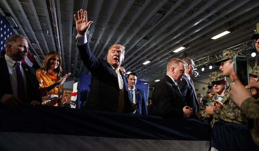 U.S. President Donald Trump talks with troops at a Memorial Day event aboard the USS Wasp amphibious assault ship, Tuesday, May 28, 2019, in Yokosuka, Japan. (AP Photo/Evan Vucci)