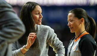 Injured Seattle Storm player Sue Bird talks with an official during a timeout in the team's WNBA basketball game against the Phoenix Mercury on Saturday, May 25, 2019, in Everett, Wash. (Dean Rutz/The Seattle Times via AP)