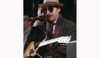 FILE - This March 28, 1998 file photo shows Leon Redbone performing at the eighth annual Redwood Coast Dixieland Jazz Festival in Eureka, Calif. Redbone, the acclaimed singer and guitarist who performed jazz, ragtime and Tin Pan Alley-styled songs, died Thursday, May 30, 2019, according to a statement released by his family. No details about his death were provided. (Patricia Wilson/The Times-Standard via AP, File)