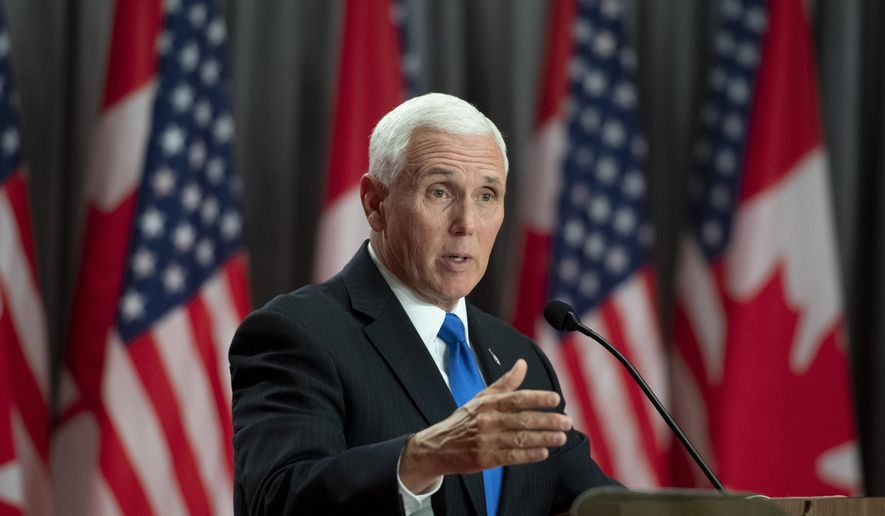 U.S. Vice-President Mike Pence participates in a joint news conference with Prime Minister Justin Trudeau, not shown, during a visit in Ottawa on Thursday, May 30, 2019. (Justin Tang/The Canadian Press via AP) ** FILE **