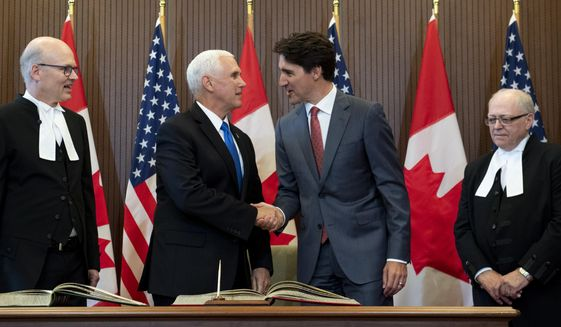 Prime Minister Justin Trudeau and U.S. Vice-President Mike Pence participate in a welcoming ceremony in West Block on Parliament Hill, as Speaker of the House of Commons Geoff Regan, left, and Speaker of the Senate George Furey, right, look on, during a visit in Ottawa on Thursday, May 30, 2019.  (Justin Tang/The Canadian Press via AP)
