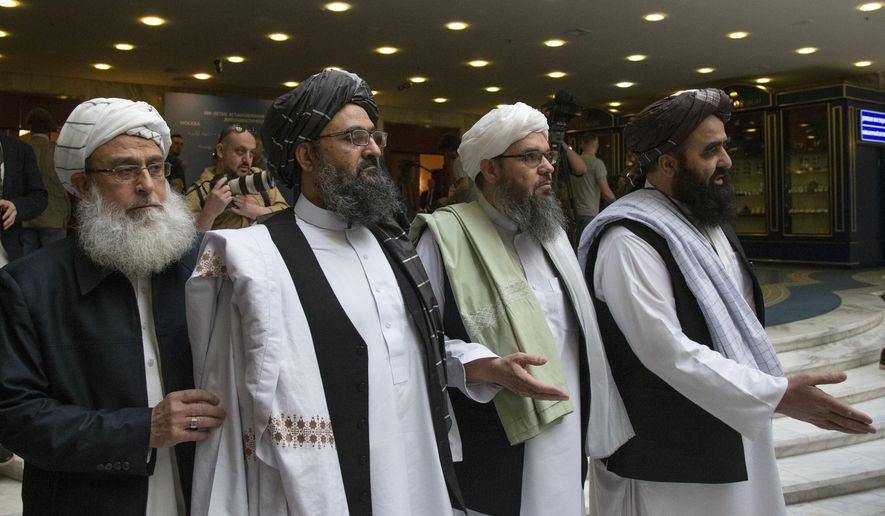 Mullah Abdul Ghani Baradar, the Taliban group's top political leader, second from left, arrives with other members of the Taliban delegation for talks in Moscow, Russia, Tuesday, May 28, 2019. Baradar and a team of 14 Taliban are in Moscow where they are scheduled to meet other Afghans including former President Hamid Karzai and some of the candidates in the presidential elections. (AP Photo/Alexander Zemlianichenko)