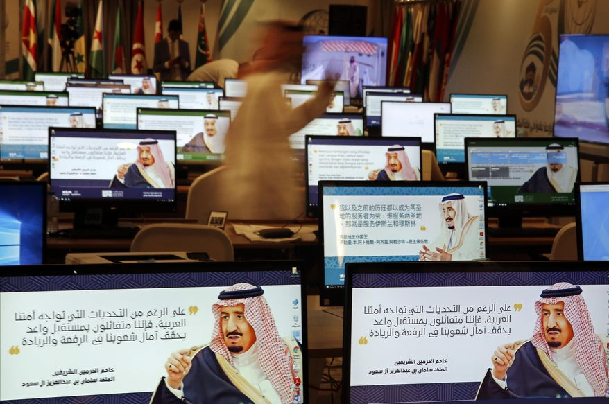 "Screensavers showing King Salman are visible on computers at the press center for upcoming summits, in Mecca, Saudi Arabia, Thursday, May 30, 2019. Salman convenes Arab heads of state from the Gulf and Arab League to discuss escalation in tension with Iran. Arabic on computers reads, ""Despite all the challenges facing our Arab nation. We are optimistic about a promising future that fulfills the hopes of our nations for leadership."" (AP Photo/Amr Nabil)"