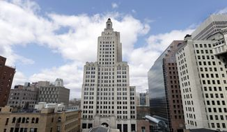 FILE - In this March 27, 2013 file photo the so-called Superman building, center, stands among other buildings in downtown Providence, R.I. Preservationists plan a discussion on the status of Rhode Island's tallest building Thursday, May 30, 2019. (AP Photo/Steven Senne, File)