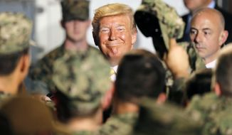 In this Tuesday, May 28, 2019, file photo, U.S. President Donald Trump greets to U.S. servicemen at U.S. Navy multipurpose amphibious assault ship USS Wasp at the U.S. Navy's Yokosuka base in Yokosuka, south of Tokyo. (AP Photo/Eugene Hoshiko, File)