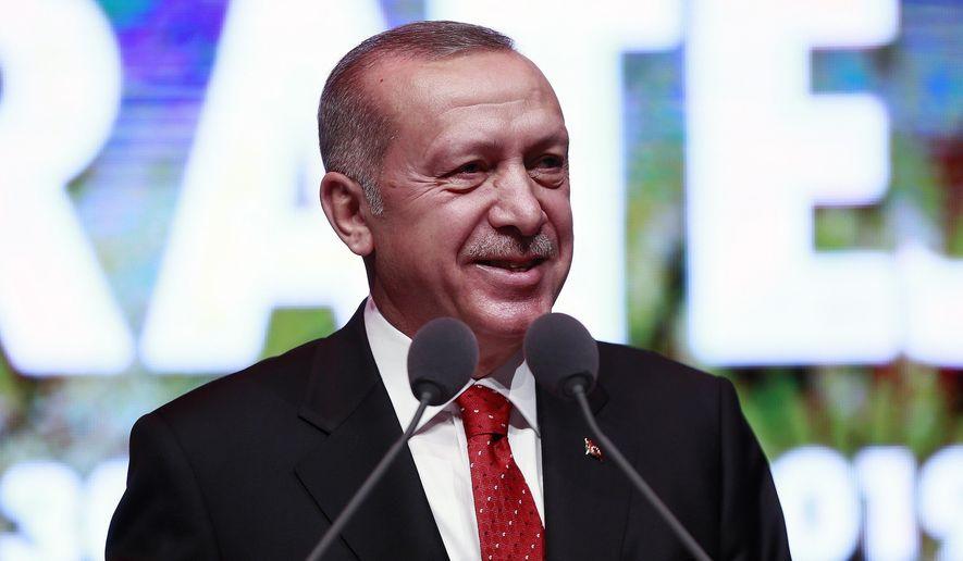 Turkey's President Recep Tayyip Erdogan smiles as he addresses a conference on judicial reform strategy, in Ankara, Turkey, Thursday, May 30, 2019. (Presidential Press Service via AP, Pool) ** FILE **