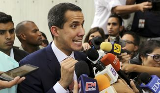 "Venezuela's opposition leader and self-proclaimed interim president Juan Guaido, speaks with the media members after a meeting of ""Plan Pais"" or Country Plan at University Catholic Andres Bello in Caracas, Venezuela, Friday, May 24, 2019.(AP Photo/Fernando Llano)"