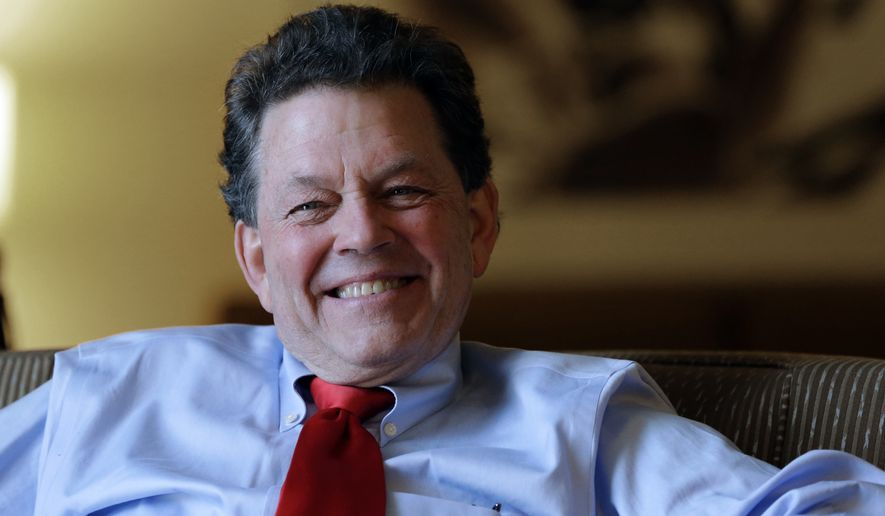 """In this Friday, Oct. 4, 2013, file photo, economist Arthur Laffer is interviewed at the California Republican Party convention in Anaheim, Calif. In their effort to overhaul the U.S. tax code, President Donald Trump and congressional Republicans are betting that by slashing taxes on corporations and rich people, the money diverted from the U.S. Treasury will find its way into the pockets of ordinary Americans. """"It will increase real wages and it will increase them substantially,'' says Laffer. (AP Photo/Reed Saxon, File)"""