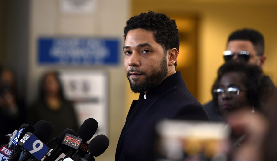 Actor Jussie Smollett talks to the media before leaving Cook County Court after his charges were dropped, in Chicago, March 26, 2019. (AP Photo/Paul Beaty) ** FILE **